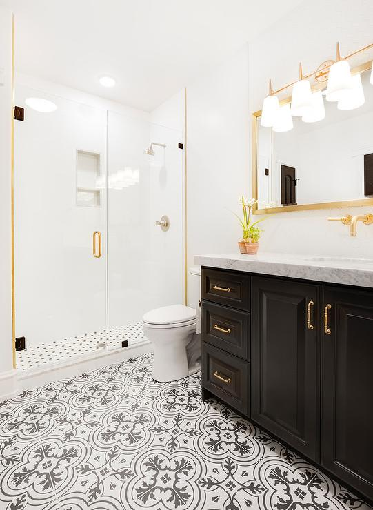 White And Gold Bathroom With Chevron Mirror Transitional