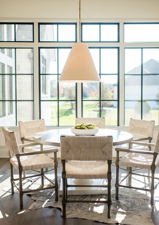 Gray Woven Chairs At Round White Lacquer Table