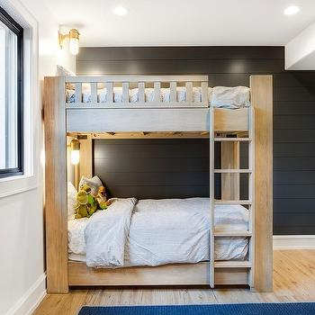 Rustic Wood Bunk Bed On Black Shiplap Wall