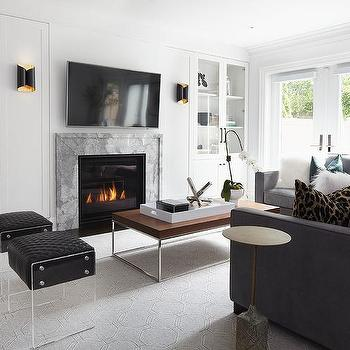 Black Sectional With Gray Hexagon Rug