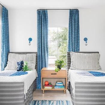 Gray Stripe Twin Beds With Blue Sconces