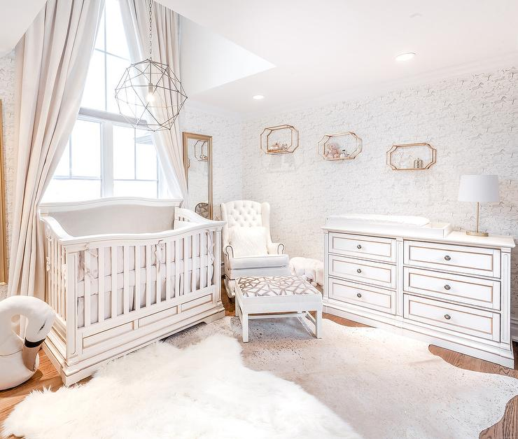 white and gray girls nursery with light gray cowhide rug transitional nursery. Black Bedroom Furniture Sets. Home Design Ideas
