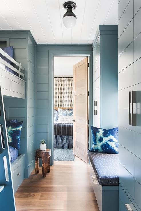 Beautiful Blue Bunk Room Is Lit By An Oil Rubbed Bronze And White Glass Flush Mount Fixed To A Shiplap Ceiling Accenting Walls