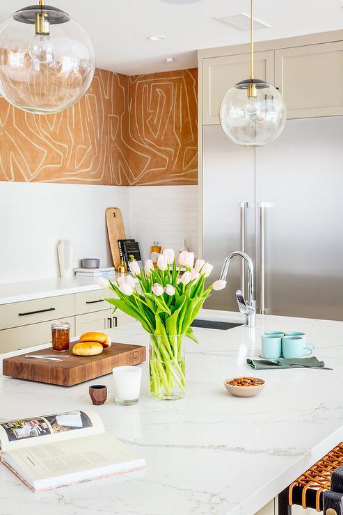 Gold Wallpaper with White Kitchen Backsplash Tiles ...