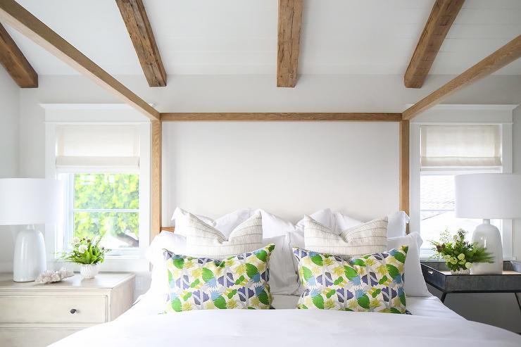 White Glass Beaded Chandelier Over Blue Velvet Tufted Sofa