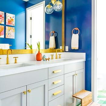 Pale Green Bathroom Vanity With Brass And Glass Pulls