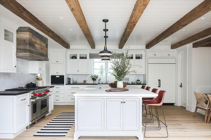 Black And White Stripe Rug In Front Of Farmhouse Island Sink