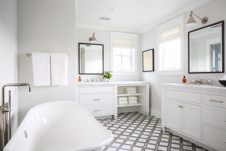 Charming White And Gray Bathroom Boasts An Oval Freestanding Bathtub Paired  With A Polished Nickel Tub Filler Fixed To White And Gray Lattice Floor  Tiles.