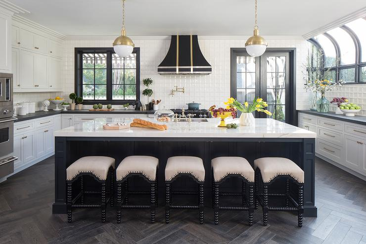 Elegant Black And White Kitchen Is Lit By Hicks Pendants Hung Over A Black  Center Island Seating Noir Abacus Stools On An Espresso Stained Wood  Herringbone ...