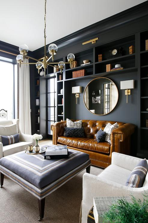 Chesterfield Sofa With Accent Chairs.Black Shelves Framing Chesterfieldsdofa Transitional Den Library