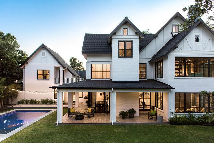 White Home Exterior With Black Shingles Transitional