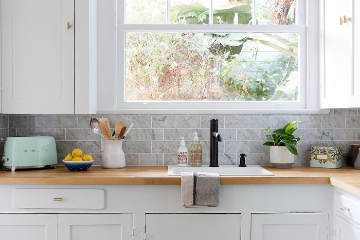 Blond Wood Countertops With White Shaker Cabinets