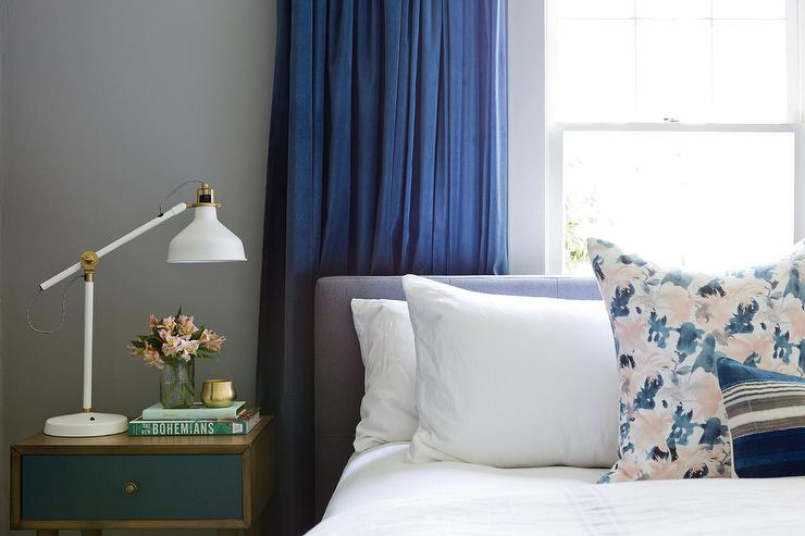 Cobalt Blue Curtains Behind Gray Headboard