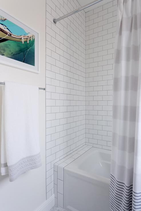 White Subway Tiled Walls In Shower And Bathtub Combo