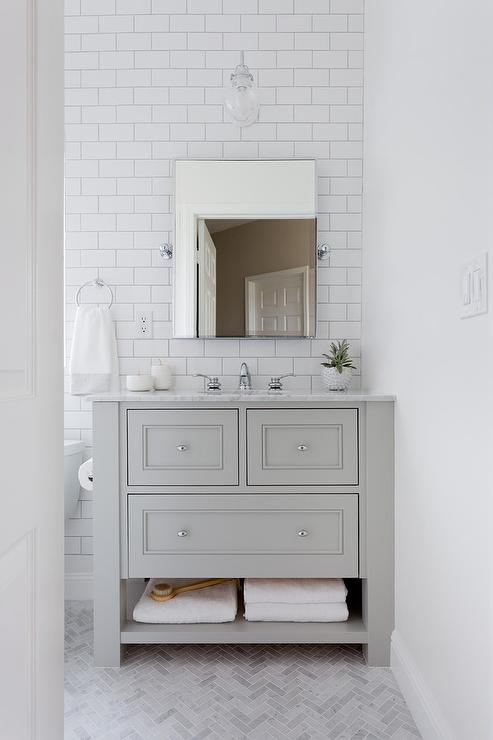 Small White Bathroom With Gray Marble Herringbone Floor