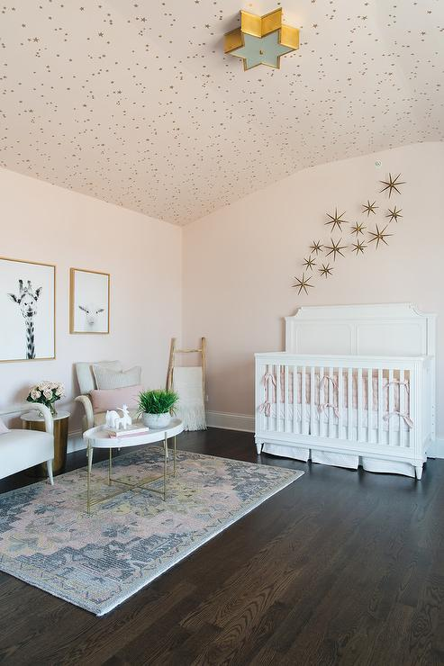 Gold Sunburst Wall Decor Over White Nursery Crib