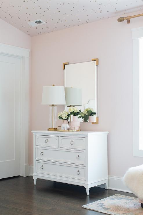 Brass And Lucite Mirror Over White French Nursery Dresser