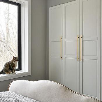 White Closet Doors With Long Brass Pulls