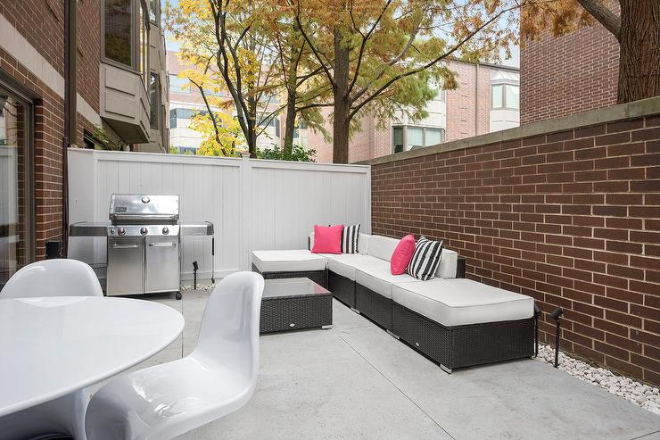 Townhouse Patio With White Panton Chairs