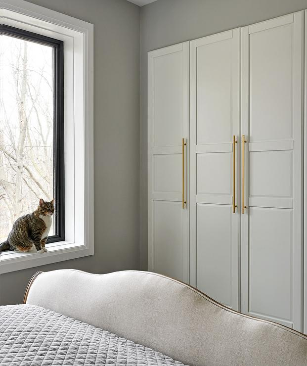 White Closet Doors With Long Brass Pulls