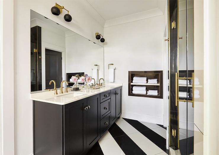 Black And White Striped Diagonal Tiles Complement A Black Shaker Bath Vanity  Accented With Brass Hardware And A White Quartz Countertop Holding Brushed  Gold ...