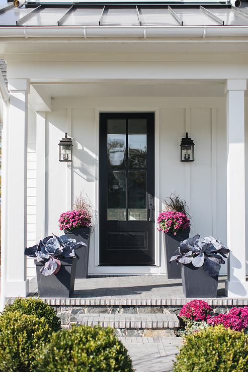 White Home With Black Door Transitional Porch