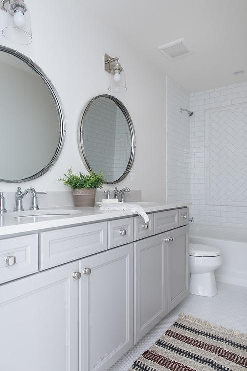 Round Mirrors Over Gray Dual Bath Vanity Transitional Bathroom