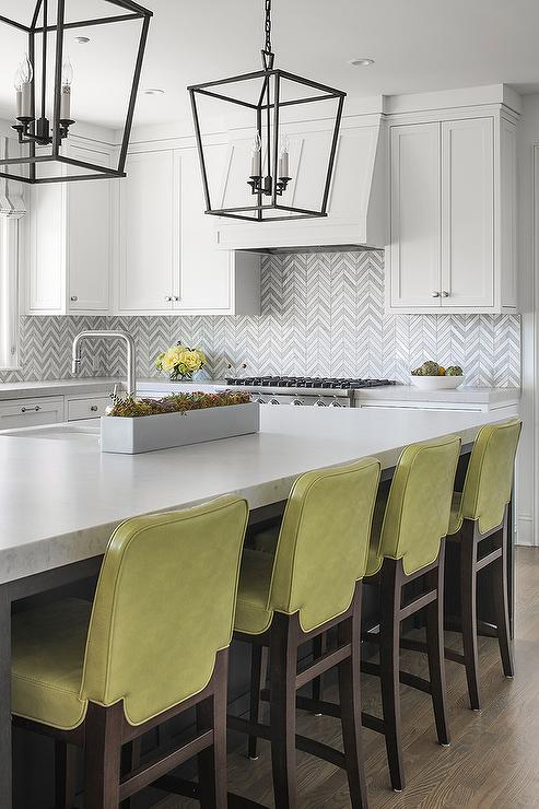 Lime green leather stools at brown oak island for Lime green kitchen wallpaper