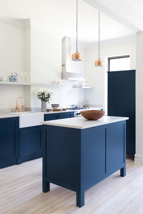 Blue Center Island With Copper Mini Lights Transitional Kitchen