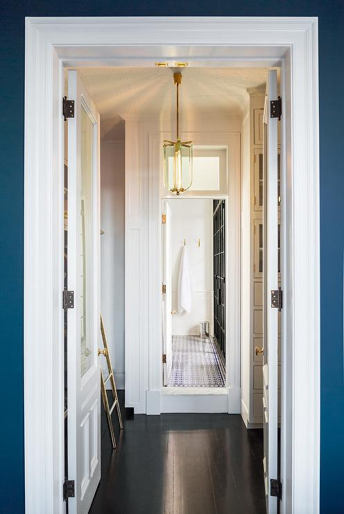 White Walk In Closet With Ebony Wood Floors Transitional Closet