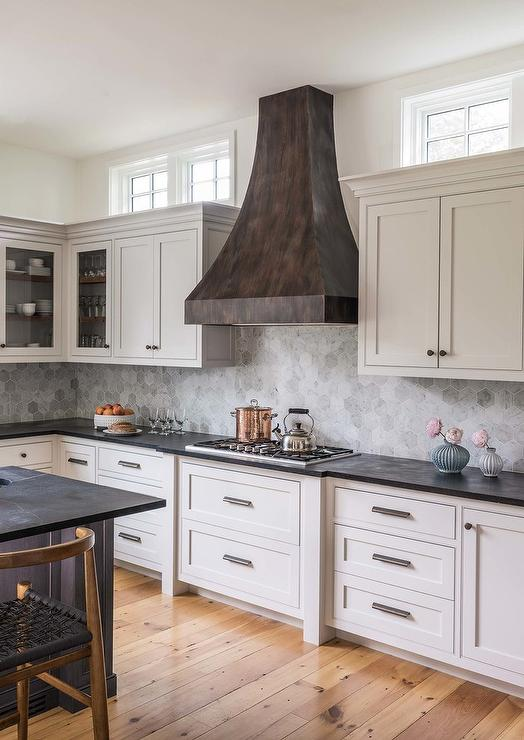 Black Metal Range Hood With White Cabinets Transitional Kitchen