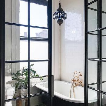 Black Moroccan Lantern Over Black Clawfoot Tub