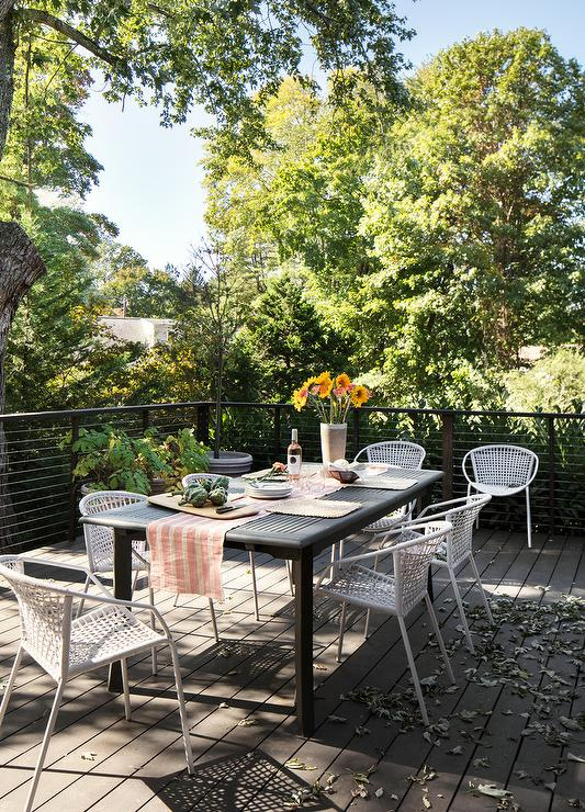 Black Slatted Outdoor Table With White Wicker Chairs Transitional
