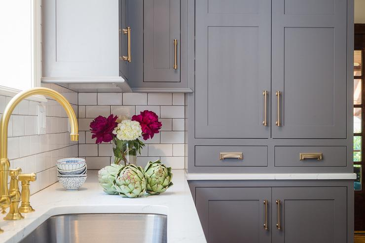 Cream Dark Gray Cabinets With Antique Brass Pulls Transitional Kitchen