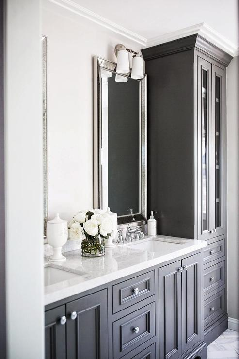 . Floor to Ceiling Black Linen Cabinets with Glass Doors