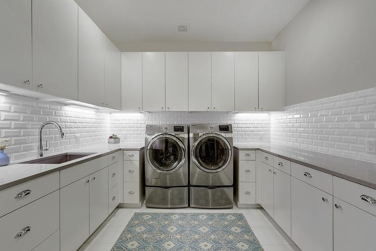 White U Shaped Laundry Room with Blue Rug - Transitional - Laundry on kitchen design with high ceilings, kitchen design with butcher block island, bathroom layout with washer dryer, kitchen design with microwave, kitchen design with lots of storage, kitchen with undercounter washer dryer, kitchen design with refrigerator, kitchen sink washer and dryer, kitchen design layout with washer dryer in it,