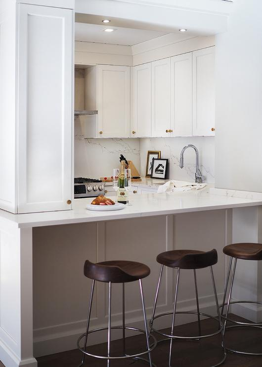 Small White Kitchen With Mini Brass And Glass Pendant