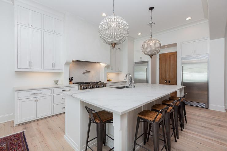 French crystal chandeliers over island transitional for Chandelier over kitchen island