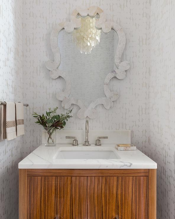 White Capiz French Mirror In A Transitional Powder Room With Zebra Wood Washstand And Marble Countertop