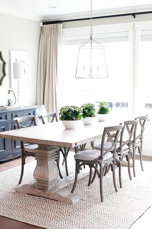 Salvaged Wood Trestle Table On Chevron Jute Rug Transitional Dining Room