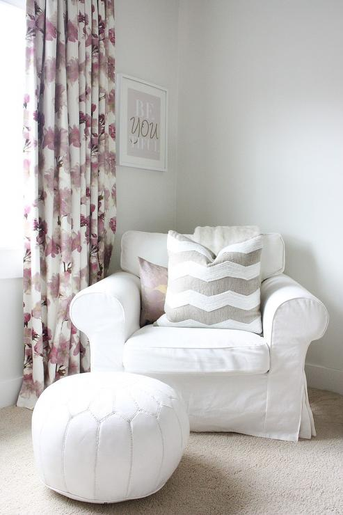 White Roll Arm Nursery Chair With Pink Floral Curtains