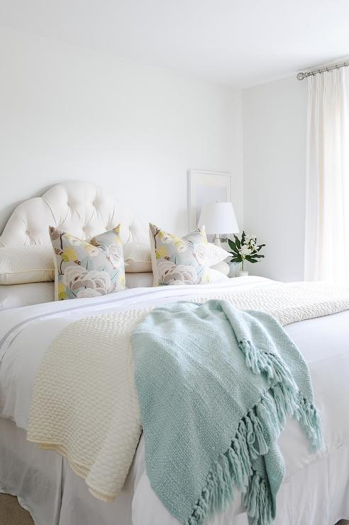 Pastel Color Pillows On White Curved Headboard