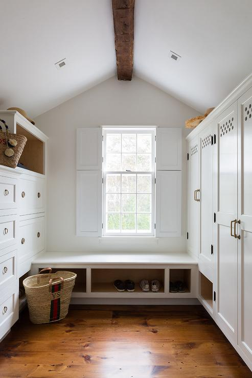 White And Blue Long Mudroom With Sloped Shiplap Ceiling