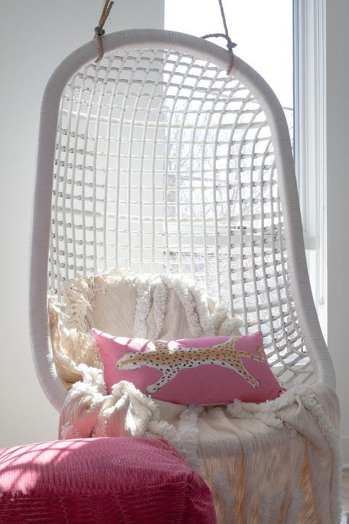 White Rattan Hanging Chair With Pink Pillow