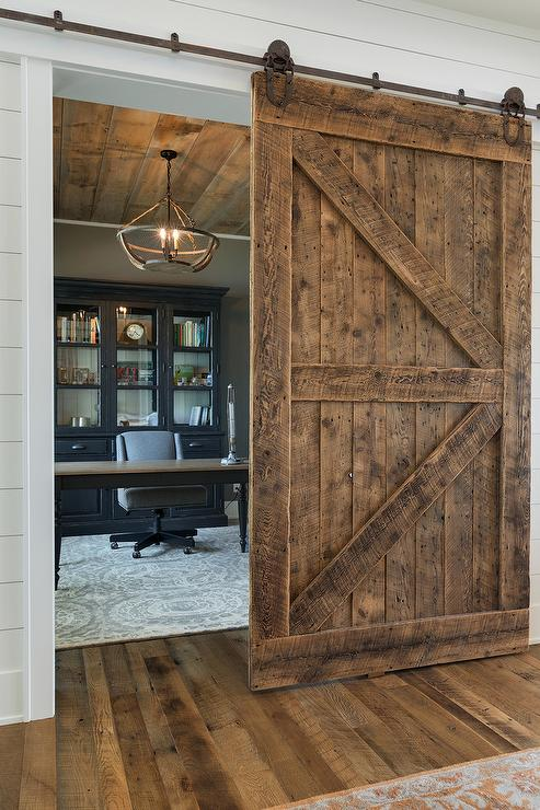 Mirrored Barn Door On Rails Transitional Bedroom