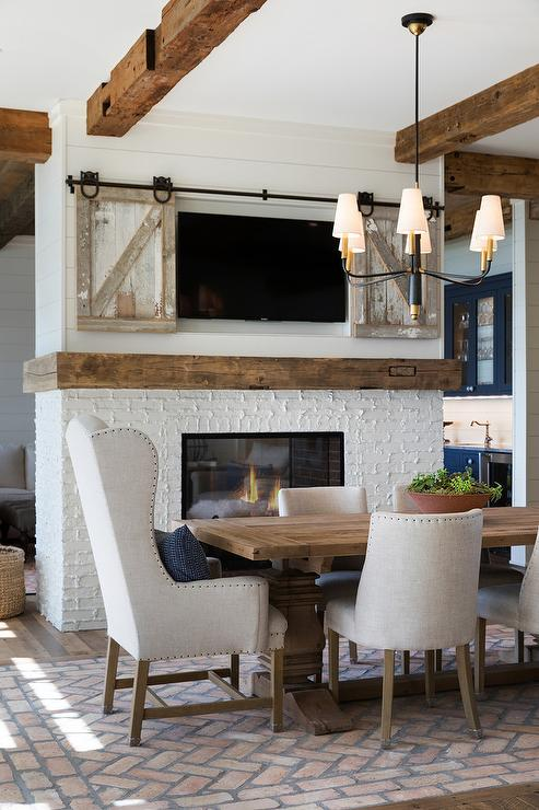 Dining Room Double Sided Fireplace With Concealed TV