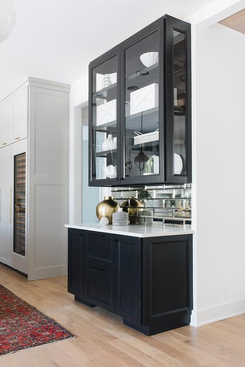Mirrored Subway Tiles With Black Glass Front Cabinets Transitional Kitchen