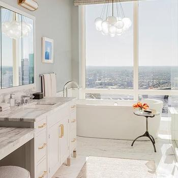 White Glass Bubbles Cluster Chandelier Over Oval Bathtub
