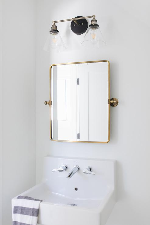 Brass Pivot Mirror With White Wall Mount Sink