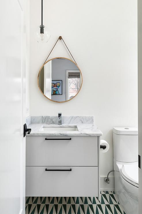 White Washstand With Blue Geometric Floor Tiles